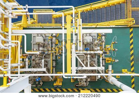 Top view of centrifugal type of pump and seal system accessories at offshore oil and gas industy Pumps drive by electric motor.