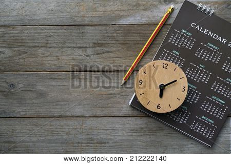 close up of clock calendar and pencil on the table planning for business meeting or travel planning concept