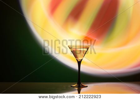 colourful cocktail on the club light background. Party club entertainment. Mixed light