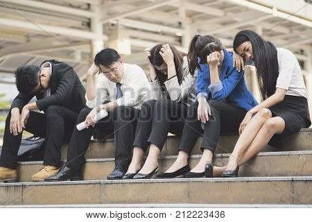 Business people unemployed from company sit on street unemployment concept