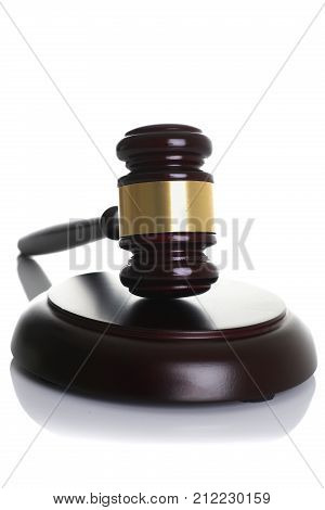 Judge hammer with stand isolated on white background for making decisions disputes of an arbitration court lawfulness actions of lawyers prosecutor and a lawyer bringing to order and responsibility.