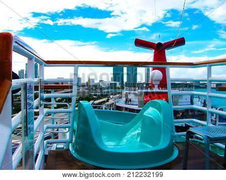 Miami, United States of America - January 5, 2014: The people resting at Carnival Glory Cruise Ship, the ship leaving Miami, USA on January 5, 2014. Carnival Glory is a Conquest-class cruise ship built in 2003 with capacity of 2974 passengers