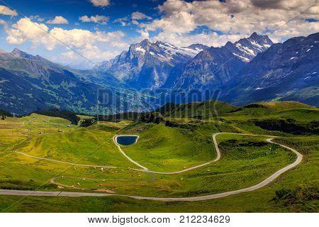 Winding road from Mannlichen to Grindelwald seen from Mannlichen in summer. Lauterbrunnen Bernese Oberland Switzerland Europe