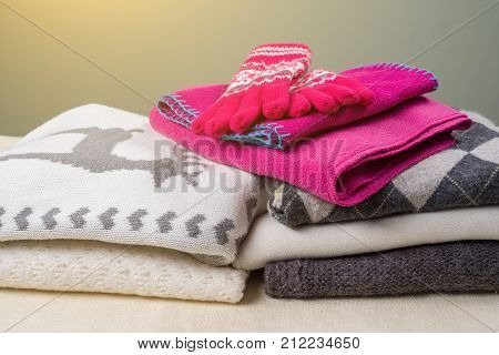 Winter time - Warm winter woolen clothes - knitted sweaters, scarves, gloves