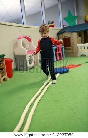 Child Playing In Game Room