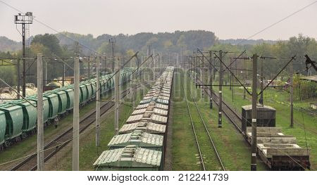 Railway station. Wagons with goods on railroad. Heavy industry.