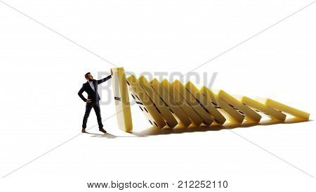 Businessman trying to stop falling domino. Business crisis management and solution concept. Isolated on white background.