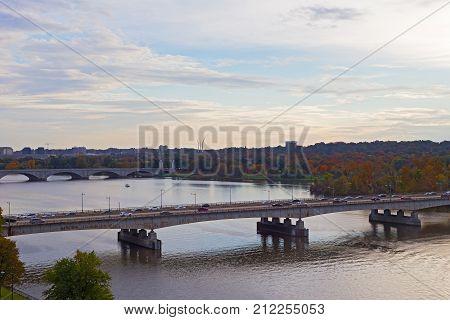 Theodore Roosevelt Bridge and Arlington Memorial Bridge at sunset in Washington DC USA. Autumn US capital panorama along Potomac River.