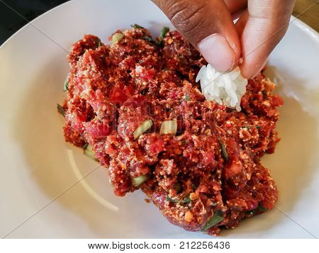 Raw spicy Thai minced beef salad Northeast Thailand food culture. Cause of tapeworm