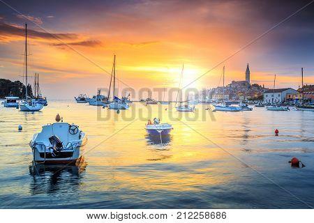 Wonderful romantic old town of Rovinj and famous fishing harbor with stunning sunset, Istrian Peninsula, Croatia, Europe