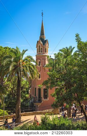 Barcelona Spain - September 24 2015: View of Gaudi house museum at Park Guell in Barcelona at Park Guell in Barcelona. Unidentified people preseent on picture. Copy space in bue sky.