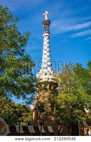 Barcelona Spain - September 24 2015: View of Spire of pavilion by architect Antoni Gaudi at Park Guell in Barcelona. Copy space in blue sky.