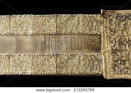 Aliseda Spain - October 29 2017: Belt representing the hero-god Melkart piece of tartessos treasure gold of Aliseda. Replica currently kept at Interpretation Centre of Aliseda Caceres Spain