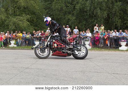 Verkhovazhye, Vologda region, Russia - August 9, 2014: Alexei Kalinin on their bike. Alexei Kalinin professional stantrayder. Champion of the Baltic States in 2005 Bronze medalist of the Baltic States in 2006 bronze medalist MOTUL M1 - Stunt Battle 2008