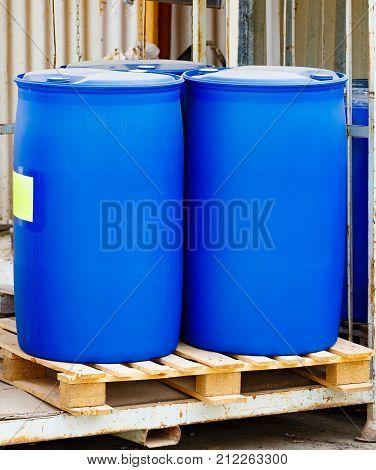 Two Blue Scratched Barrels