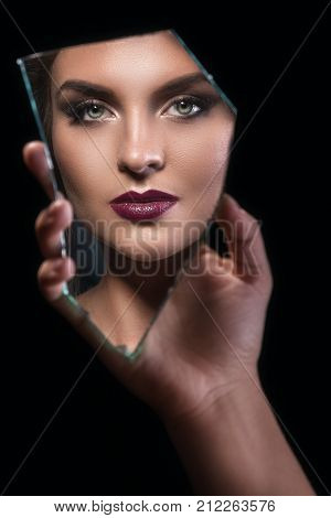 Splinter Of Mirror With Female Face In Reflection