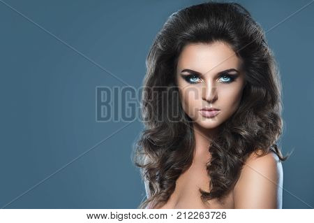 Stunning Woman With Beautiful Makeup And Hairdo