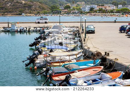 RHODES, GREECE - AUGUST 2017: Port of Rhodes town with moored fishing boats near the pier.