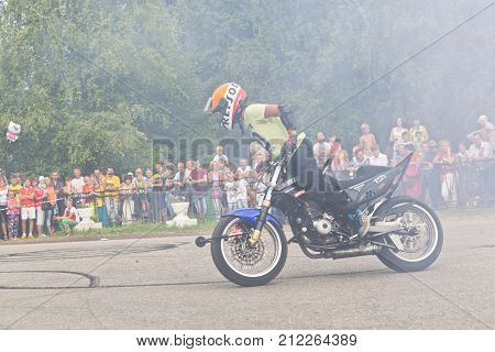 Verkhovazhye, Vologda region, Russia - August 9, 2014: Lots of smoke on Moto show in Verkhovazhye, Vologda region, Russia. Foma Kalinin young stunt