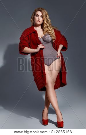 Plus Size Model Wearing Lingerie And Red Knitted Coat