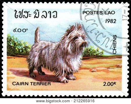 LAOS - CIRCA 1982: a postage stamp,  printed in Laos, shows a Cairn Terrier dog
