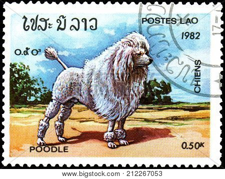 LAOS - CIRCA 1982: a postage stamp, printed in Laos, shows a Poodle dog