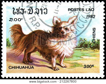 LAOS - CIRCA 1982: a postage stamp, printed in Laos, shows a Chihuahua dog