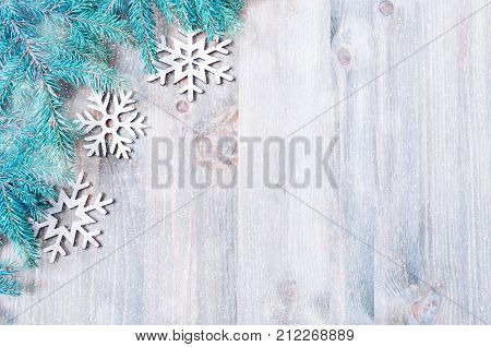 New Year and Christmas background. Christmas toys blue fir tree branches on the wooden background. New Year and Christmas still life. Christmas and New Year composition, free space. New Year background. Festive still life, New Year and Christmas concept