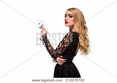 Beautiful blonde in a black dress with casino cards two aces in hands isolated on a white background. Poker. Casino. Roulette Blackjack Spin. Caucasian young woman looking at the camera. Winning combination poster