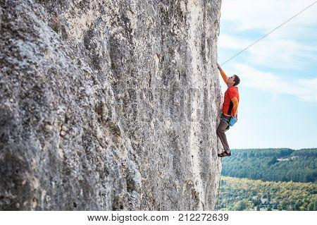 A Rock Climber On A Rock.