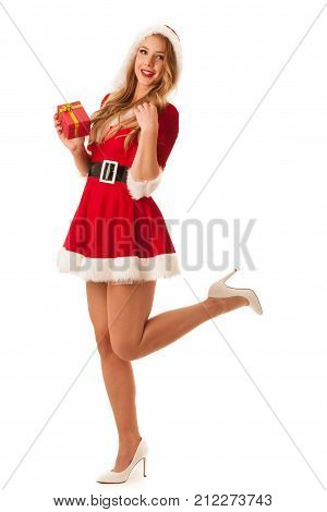 Full Length Portrait Of A Woman In Santa Calus Dress Holding A Present Isolated Over White Backgroun