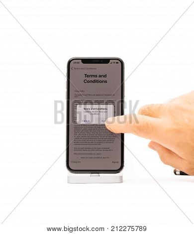 Paris France - Nov 5 2017: New Apple Iphone X 10 Smartphone Isolated White Background Man Hand Press