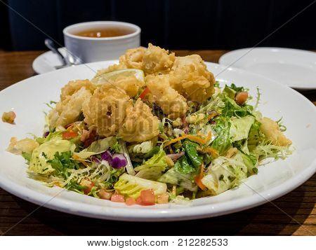 Calamari With Salad In White Dish