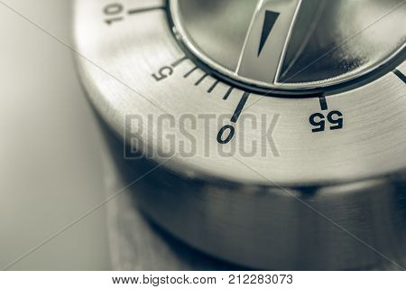 0 Minutes - 1 Hour - Macro Of An Analog Chrome Kitchen Timer On Wooden Table