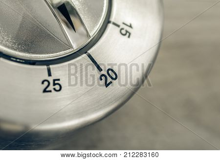 20 Minutes - Macro Of An Analog Chrome Kitchen Timer On Wooden Table