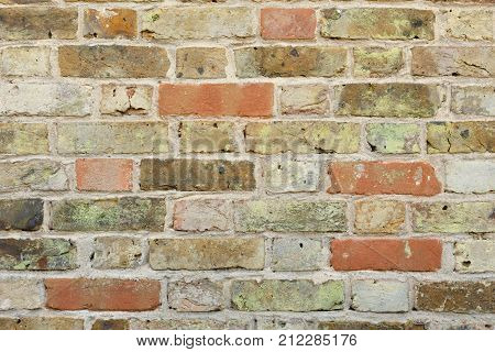Old rustic brick wall background closeup detail