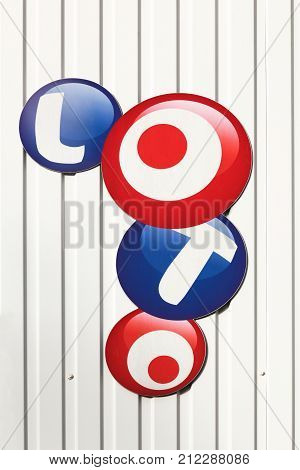 Nespouls, France - June 6, 2017: French loto logo on a wall. Franaise des Jeux also called FDJ is the operator of the loto game in France