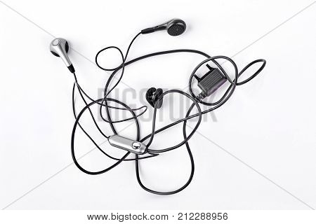 Earphones isolated on white background. Black earphones isolated on white background.