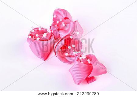 Pair of hair bows on white background. Beautiful pink bow ties isolated on white background.