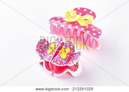 Pink plastic hair clips with bow. Kids beautiful design clips for hair. Girls hair accessory.