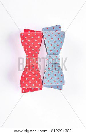 Elegant bow ties on white background. Textile hair bows with colorful spots isolated on white background. Kids classic hair accessories.