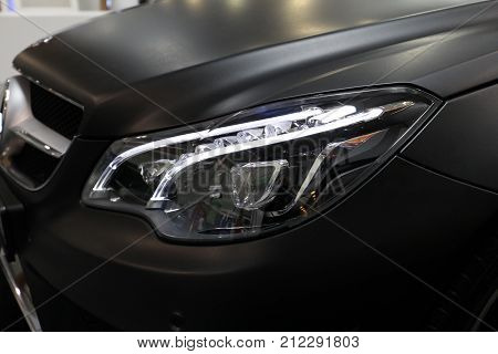CRACOW POLAND - MAY 20 2017: Mercedes front headlight displayed at 3rd edition of MOTO SHOW in Cracow Poland. Exhibitors present most interesting aspects of the automotive industry