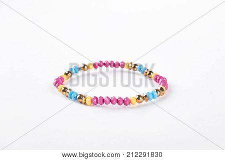 Colorful childrens bracelet for girls. Multicolored beaded kids bracelet isolated on white background.