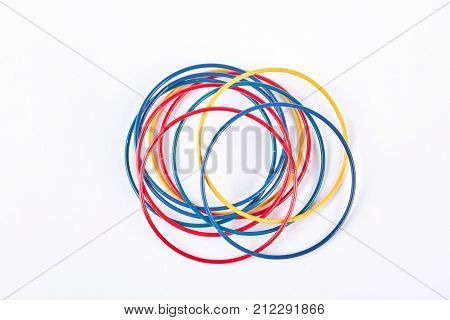 Set of colored bracelets, top view. Collection of plastic multicolored bangles on white background. Girls fashion accessories.