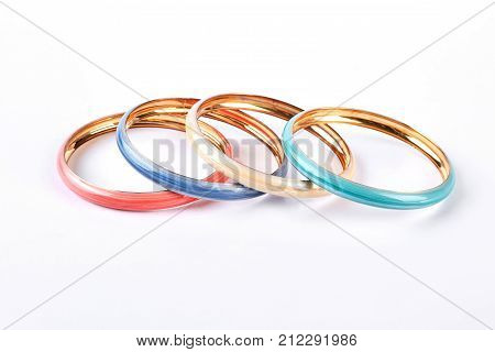 Four fashion color bracelets. Set of female modern bracelets isolated on white background. Woman fashion accessories.
