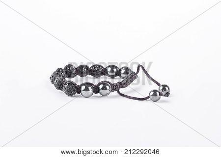 Beautiful stones bracelet shamballa. Popular buddhist bracelet shamballa isolated on white background. Woman fashion hand accessory.