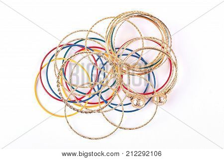 Collection of fashion bracelets, top view. Plastic and golden bangles on white background. Hand accessories for women.