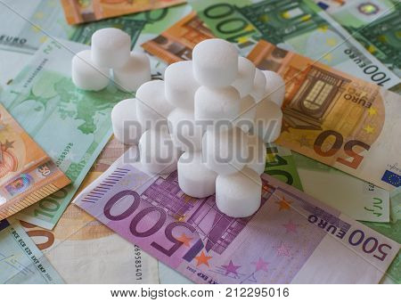 Salt Pellets For The Water Softener On The Background Of Euro Banknotes