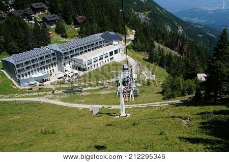 Mozirje, Slovenia - August 3, 2017: Unidentified tourist in a cableway in front of Moutain Hotel Golte in de Slovenian city of Mozirje, Europe.