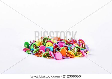 Pile of multicolored push pins. Heap of colorful push pins isolated on white background. Variety of push pins of different colors.